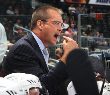 ATLANTA - SEPTEMBER 25: Head Coach Paul Maurice of the Carolina Hurricanes disputes a call during the game against the Atlanta Thrashers at Philips Arena on September 25, 2010 in Atlanta, Georgia. The Hurricanes won 1-0. (Photo by Scott Cunningham/Getty I