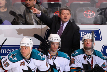 GLENDALE, AZ - JANUARY 12:  Head coach Todd McLellan of the San Jose Sharks directs his team during the NHL game against the Phoenix Coyotes at Jobing.com Arena on January 12, 2010 in Glendale, Arizona. The Sharks defeated the Coyotes 3-1. (Photo by Chris