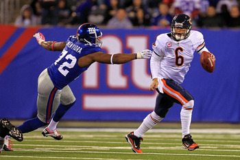 EAST RUTHERFORD, NJ - OCTOBER 03:  Jay Cutler #6 of the Chicago Bears gets chased by Osi Umenyiora #72 of the New York Giants at New Meadowlands Stadium on October 3, 2010 in East Rutherford, New Jersey.  (Photo by Chris McGrath/Getty Images)