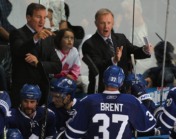 LONDON,ON - SEPTEMBER 23: Coaches Ron Wilson and Tim Hunter of the Toronto Maple Leafs give instruction prior to a shootout in a pre-season game against the Philadelphia Flyers on September 23,2010 at the John Labatt Centre in London, Ontario. The Leafs d