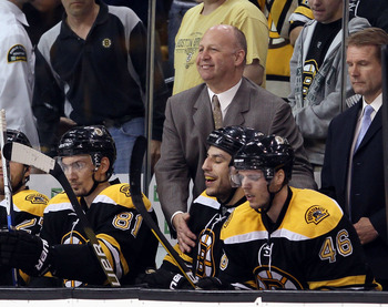 BOSTON - MAY 03:  Head coach Claude Julien of the Boston Bruins congratulates Milan Lucic #17 after he scored the game winner in the third period against the Philadelphia Flyers in Game Two of the Eastern Conference Semifinals during the 2010 NHL Stanley