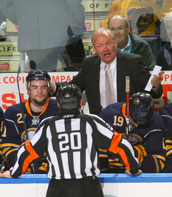 BUFFALO, NY - APRIL 23: Lindy Ruff , head coach of the Buffalo Sabres talks to referee Tim Peel #20 during a tim out against the Boston Bruins in Game Five of the Eastern Conference Quarterfinals during the 2010 NHL Stanley Cup Playoffs at HSBC Arena on A