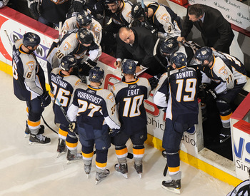 NASHVILLE, TN - APRIL 26: Coach Barry Trotz of the Nashville Predators draws up a play during a timeout against the Chicago Blackhawks in Game Six of the Western Conference Quarterfinals during the 2010 NHL Stanley Cup Playoffs at Bridgestone Arena on Apr