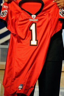 NEW YORK - APRIL 22:  Gerald McCoy from the Oklahoma Sooners holds a Tampa Bay Buccaneers jersey after he was selected by the Buccaneers number 3 overall during the first round of the 2010 NFL Draft at Radio City Music Hall on April 22, 2010 in New York C