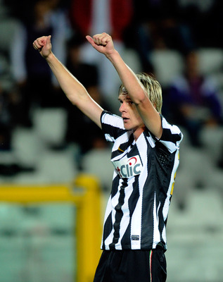 TURIN, ITALY - SEPTEMBER 26:  Milos Krasic of Juventus FC celebrates after the fourth goal during the Serie A match between Juventus and Cagliari at Olimpico Stadium on September 26, 2010 in Turin, Italy.  (Photo by Claudio Villa/Getty Images)