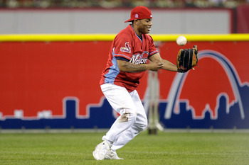 ST LOUIS, MO - JULY 12:  Rapper Nelly takes part in the Taco Bell All-Star Legends & Celebrity Softball Game at Busch Stadium on July 12, 2009 in St. Louis, Missouri.  (Photo by Jamie Squire/Getty Images)
