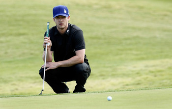 LAS VEGAS - OCTOBER 14:  Singer Justin Timberlake watches another player's ball roll by on the 8th hole green during the Justin Timberlake Shriners Hospitals for Children Open Championship Pro-Am at the TPC Summerlin October 14, 2009 in Las Vegas, Nevada.