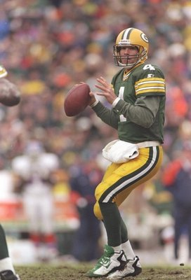 8 Dec 1996:  Quarterback Brett Favre of the Green Bay Packers drops back to pass during a game against the Denver Broncos at Lambeau Field in Green Bay, Wisconsin.  The Packers won the game 41-6. Mandatory Credit: Brian Bahr  /Allsport