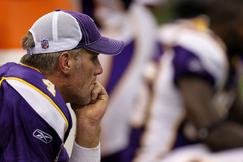 NEW ORLEANS - SEPTEMBER 09:  Quarterback Brett Favre #4 of the Minnesota Vikings sits on the bench dejected late in the fourth quarter against the New Orleans Saints at Louisiana Superdome on September 9, 2010 in New Orleans, Louisiana. The Saints won 14-