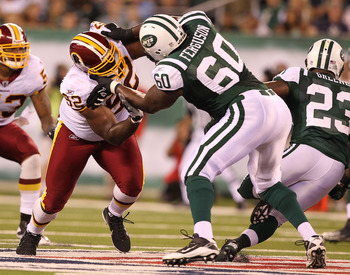 EAST RUTHERFORD, NJ - AUGUST 27:  Albert Haynesworth #92 of the Washington Redskins battles D'Brickashaw Ferguson #60 of the New York Jets during their preseason game on August 27, 2010 at the New Meadowlands Stadium  in East Rutherford, New Jersey.  (Pho