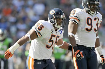 SEATTLE - SEPTEMBER 27: Lance Briggs #55 of the Chicago Bears moves on the field as Adewale Ogunleye #93 looks on during the game against the Seattle Seahawks on September 27, 2009 at Qwest Field in Seattle, Washington. The Bears defeated the Seahawks 25-