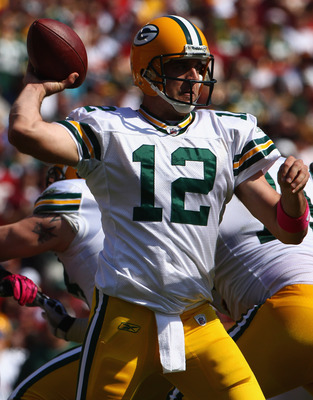 LANDOVER, MD - OCTOBER 10:  Quarterback Aaron Rodgers #12 of the Green Bay Packers throws a pass against the Washington Redskins at FedExField on October 10, 2010 in Landover, Maryland. The Redskins won the game in overtime 16-13.  (Photo by Win McNamee/G