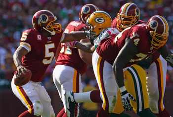 LANDOVER, MD - OCTOBER 10:  Donovan McNabb #5 of the Washington Redskins scrambles in the pocket against the Green Bay Packers at FedExField on October 10, 2010 in Landover, Maryland. The Redskins won the game in overtime 16-13.  (Photo by Win McNamee/Get
