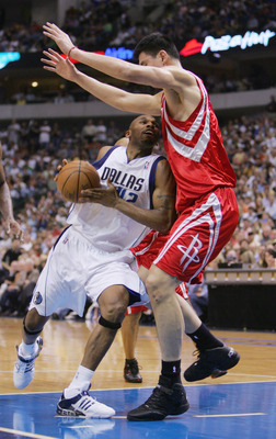 DALLAS - MAY 7:  Yao Ming #11 of the Houston Rockets blocks the path of Jerry Stackhouse #42 of the Dallas Mavericks in Game seven of the Western Conference Quarterfinals during the 2005 NBA Playoffs at the American Airlines Center on May 7, 2005 in Dalla