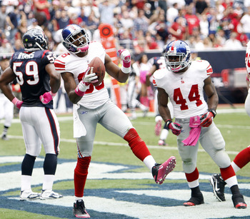 HOUSTON - OCTOBER 10:  Wide receiver Hakeem Nicks #88 celebrates with Ahmad Bradshaw #44 after scoring on a passs in the second quarter at Reliant Stadium on October 10, 2010 in Houston, Texas.  (Photo by Bob Levey/Getty Images)