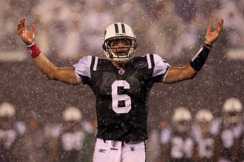 EAST RUTHERFORD, NJ - OCTOBER 11:  Mark Sanchez #6 of the New York Jets reacts as rain falls during the second quarter against the Minnesota Vikings at New Meadowlands Stadium on October 11, 2010 in East Rutherford, New Jersey.  (Photo by Jim McIsaac/Gett