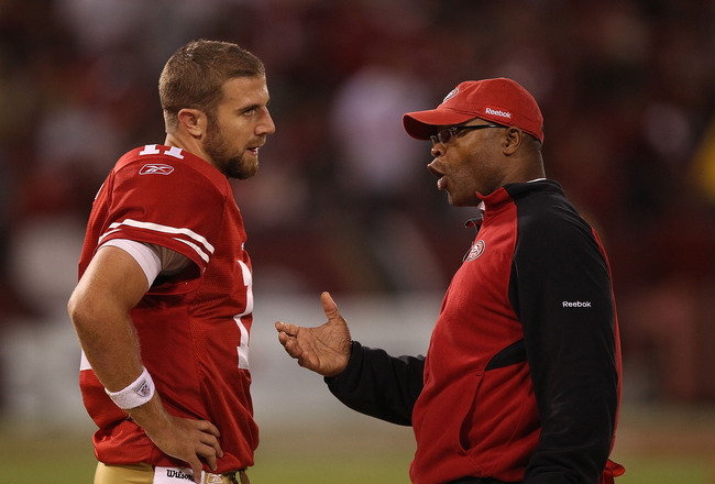SAN FRANCISCO - OCTOBER 10:  Head coach Mike Singletary of the San Francisco 49ers talks with quarterback Alex Smith #11 against the Philadelphia Eagles during an NFL game at Candlestick Park on October 10, 2010 in San Francisco, California.  (Photo by Je