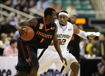 GREENSBORO, NC - MARCH 11:  L.D. Williams #42 of the Wake Forest Demon Deacons guards Durand Scott #1 of the University of Miami Hurricanes in their first round game in the 2010 ACC Men's Basketball Tournament at the Greensboro Coliseum on March 11, 2010