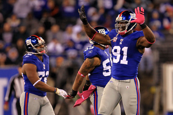 EAST RUTHERFORD, NJ - OCTOBER 03:  Justin Tuck #91 of the New York Giants celebrates after the tenth sack of the game against the Chicago Bear at New Meadowlands Stadium on October 3, 2010 in East Rutherford, New Jersey.  (Photo by Chris McGrath/Getty Ima