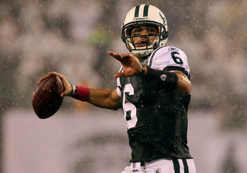 EAST RUTHERFORD, NJ - OCTOBER 11:  Mark Sanchez #6 of the New York Jets throws a pass in the rain during the second quarter against the Minnesota Vikings at New Meadowlands Stadium on October 11, 2010 in East Rutherford, New Jersey.  (Photo by Jim McIsaac