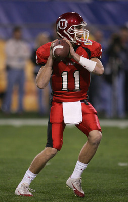 TEMPE, AZ - JANUARY 1:  Quarterback Alex Smith #11 of Utah drops back for a pass against Pittsburgh during the Tostito's Fiesta Bowl at the Sun Devil Stadium on January 1, 2005 in Tempe, Arizona. Utah won the game with the score of 35-7. (Photo by Harry H