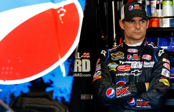 FONTANA, CA - OCTOBER 09:  Jeff Gordon, driver of the #24 DuPont Chevrolet, stands in the garage during practice for the NASCAR Sprint Cup Series Pepsi Max 400 on October 9, 2010 in Fontana, California.  (Photo by Jason Smith/Getty Images for NASCAR)