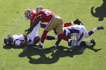 SAN FRANCISCO - AUGUST 22:  Brett Favre #4 of the Minnesota Vikings is sacked by Patrick Willis #52 and Takeo Spikes #51 of the San Francisco 49ers during an NFL pre-season game at Candlestick Park on August 22, 2010 in San Francisco, California.  (Photo