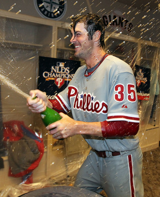 CINCINNATI - OCTOBER 10:  Cole Hamels #35 of the Philadelphia Phillies sprays champagne in the clubhouse after throwing a complete game shut-out to sweep the Cincinnati Reds during Game 3 of the NLDS at Great American Ball Park on October 10, 2010 in Cinc