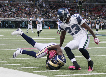ST. LOUIS - OCTOBER 03:  Mark Clayton #89 of the St. Louis Rams makes the catch as Marcus Trufant #23 of the Seattle Seahawks defends on October 3, 2010 at Edward Jones Dome in St. Louis, Missouri.  (Photo by Elsa/Getty Images)