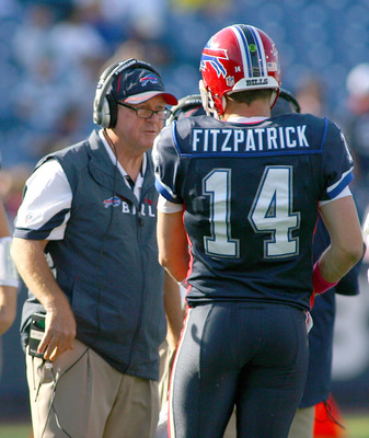 ORCHARD PARK, NY - OCTOBER 10:  Chan Gailey, head coach of the Buffalo Bills  talks to Ryan Fitzpatrick #24 during a timeout against the Jacksonville Jaguars at Ralph Wilson Stadium on October 10, 2010 in Orchard Park, New York. Jacksonville won 36-26.  (