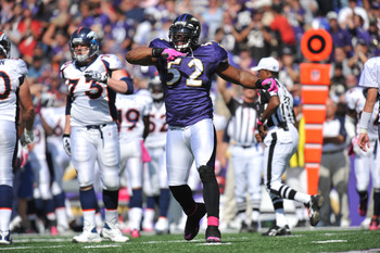 BALTIMORE, MD - OCTOBER 10:  Ray Lewis #52 of the Baltimore Ravens celebrates a play against the Denver Broncos at M&T Bank Stadium on October 10, 2010 in Baltimore, Maryland. Players wore pink in recognition of Breast Cancer Awareness Month. The Ravens l