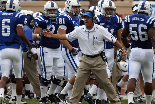 DURHAM, NC - SEPTEMBER 25:  Head coach David Cutcliffe of the Duke Blue Devils cheers on his team the Army Black Knights at Wallace Wade Stadium on September 25, 2010 in Durham, North Carolina.  (Photo by Streeter Lecka/Getty Images)
