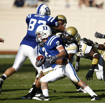 DURHAM, NC - NOVEMBER 14:  Morgan Burnett #1 and a group of Georgia Tech Yellow Jackets defenders tackle Conner Vernon #2 of the Duke Blue Devils at Wallace Wade Stadium on November 14, 2009 in Durham, North Carolina. (Photo by Joe Robbins/Getty Images)