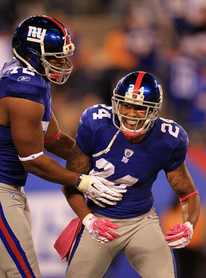 EAST RUTHERFORD, NJ - OCTOBER 03:  Terrell Thomas #24 of the New York Giants celebrates after an interception against the Chicago Bears with teammate Osi Umenyiora #72 at New Meadowlands Stadium on October 3, 2010 in East Rutherford, New Jersey.  (Photo b