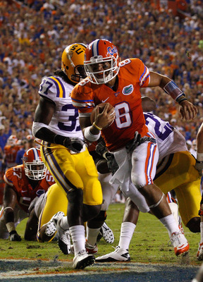 GAINESVILLE, FL - OCTOBER 09:  Quarterback Trey Burton #8 of the Florida Gators scores a touchdown during the game against the Louisiana State University Tigers at Ben Hill Griffin Stadium on October 9, 2010 in Gainesville, Florida.  (Photo by Sam Greenwo