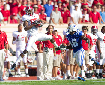 DURHAM, NC - SEPTEMBER 18: Earl Alexander #82 of the Alabama Crimson Tide makes a catch in front of Chris Rwabukamba #16 of the Duke Blue Devils at Wallace Wade Stadium on September 18, 2010 in Durham, North Carolina.  The Crimson Tide defeated the Blue D