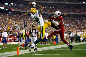 GLENDALE, AZ - JANUARY 03:  Jermichael Finley #88 of the Green Bay Packers catches a five-yard touchdown pass over Greg Toler #28 of the Arizona Cardinals in the third quarter at University of Phoenix Stadium on January 3, 2010 in Glendale, Arizona.  (Pho
