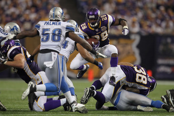 MINNEAPOLIS - SEPTEMBER 26:  Running back Adrian Peterson #28 of the Minnesota Vikings jumps through a hole while carrying the ball against the Detroit Lions during the second half at Mall of America Field on September 26, 2010 in Minneapolis, Minnesota.