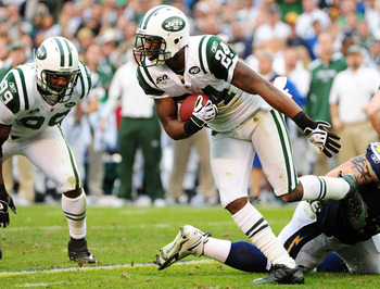 SAN DIEGO - JANUARY 17:  Cornerback Darrelle Revis #24 of the New York Jets runs after making an interception against the San Diego Chargers during  AFC Divisional Playoff Game at Qualcomm Stadium on January 17, 2010 in San Diego, California.  (Photo by R