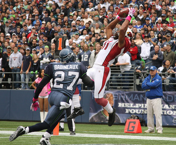 SEATTLE - OCTOBER 18: Wide receiver Larry Fitzgerald #11 of the Arizona Cardinals makes a touchdown catch against Jordan Babineaux #27 of the Seattle Seahawks on October 18, 2009 at Qwest Field in Seattle, Washington. (Photo by Otto Greule Jr/Getty Images