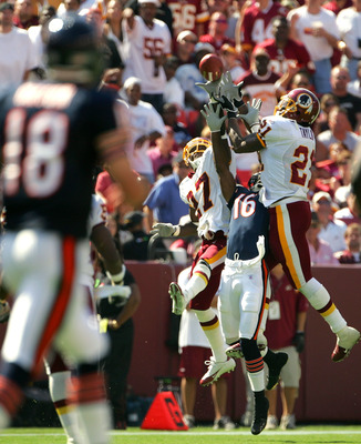 LANDOVER, MD - SEPTEMBER 11:  Quarterback Kyle Orton #18 of the Chicago Bears looks on as Sean Taylor #21 and Walt Harris #27 of the Washington Redskins break up a pass intended for Mark Bradley #16 during the second half of the game on September 11, 2005