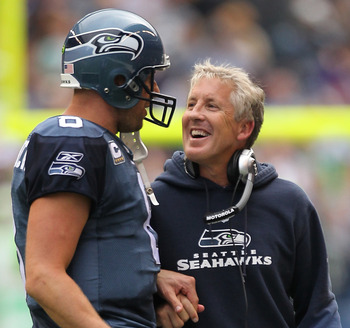 SEATTLE - SEPTEMBER 26:  Head coach Pete Carroll of the Seattle Seahawks smiles as he talks to quarterback Matt Hasselbeck #8 after a touchdown against the San Diego Chargers at Qwest Field on September 26, 2010 in Seattle, Washington. The Seahawks defeat
