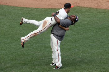 SAN FRANCISCO - OCTOBER 03:  Pablo Sandoval #48 of the San Francisco Giants lifts teammate Andres Torres #56 after they clinched the National League West divsion against the San Diego Padres at AT&T Park on October 3, 2010 in San Francisco, California.  T