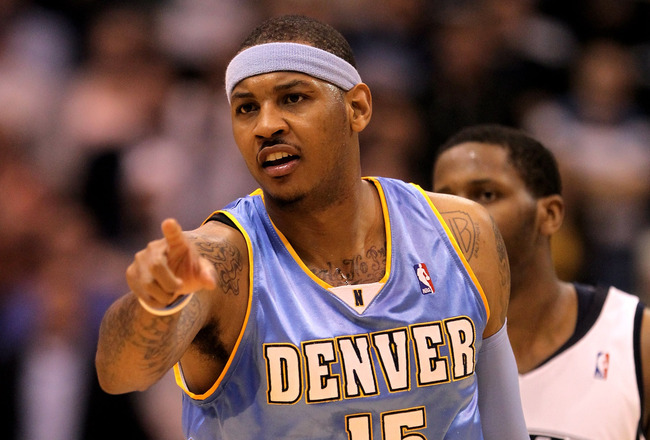 SALT LAKE CITY - APRIL 30:  Carmelo Anthony #15 of the Denver Nuggets points to his teammate during their game against the Utah Jazz in Game Six of the Western Conference Quarterfinals of the 2010 NBA Playoffs at EnergySolutions Arena on April 30, 2010 in