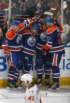 EDMONTON, CANADA - OCTOBER 7:  James Vandermeer #2 and Dustin Penner #27 of the Edmonton Oilers celebrate with teammates against the Calgary Flames at Rexall Place October 7, 2010 in Edmonton, Alberta, Canada. (Photo by Dale MacMillan/Getty Images)