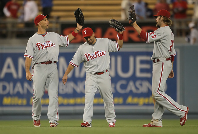 LOS ANGELES, CA - AUGUST 31:  (L-R) Raul Ibanez #29, Shane Victorino #8 and Jayson Werth #28 of the Philadelphia Phillies celebrate following their teams victory over the Los Angeles Dodgers at Dodger Stadium on August 31, 2010 in Los Angeles, California.