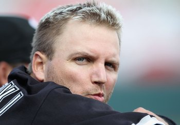 PHOENIX - MARCH 10:  A.J. Pierzynski #12 of the Chicago White Sox sits in the dugout during the MLB spring training game against the Oakland Athletics at Phoenix Municipal Stadium on March 10, 2010 in Phoenix, Arizona. The White Sox defeated the A's 9-5
