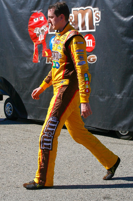 FONTANA, CA - OCTOBER 10:  Kyle Busch, driver of the #18 M&M'sToyota, walks in the garage area after blowing a motor during the NASCAR Sprint Cup Series Pepsi Max 400 on October 10, 2010 in Fontana, California.  (Photo by Jason Smith/Getty Images for NASC