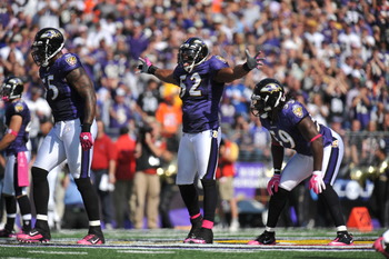 BALTIMORE, MD - OCTOBER 10:  Ray Lewis #52 of the Baltimore Ravens rouses the crowd before a play against the Denver Broncos at M&T Bank Stadium on October 10, 2010 in Baltimore, Maryland. Players wore pink in recognition of Breast Cancer Awareness Month.