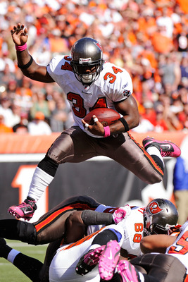 CINCINNATI, OH - OCTOBER 10:  Earnest Graham #34 of the Tampa Bay Buccaneers leaps over a pile of players on his way to a one-yard touchdown run against the Cincinnati Bengals in the third quarter at Paul Brown Stadium on October 10, 2010 in Cincinnati, O